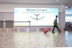 PRAGUE,CZECH REPUBLIC - 10-03-2016: A man walks down the concourse at Vaclav Havel International Airport in Prague stock photography