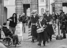 Prague, Czech Republic - March 13, 2017: Military musicians are passing by tourists Black and white image royalty free stock image
