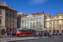 Old Tramway in Prague. Prague, Czech Republic - March 16, 2017: An old red tramway at a station with people waiting Royalty Free Stock Photo