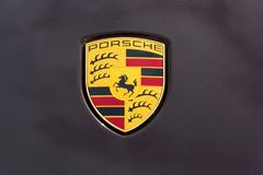 Porsche automotive company logo on car bonnet. PRAGUE, CZECH REPUBLIC - MARCH 29 2018: Porsche automotive company logo on car bonnet on on March 29, 2018 in Royalty Free Stock Images