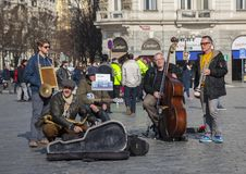 Prague, Czech Republic - March 13, 2017: Quartet of Musicians playing musical instruments for tourists on the street in Prague royalty free stock photography