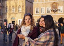 Prague, Czech Republic - March 15 2017: Self portrait of cheerful pretty girls shooting selfie on front camera having leisure royalty free stock photography