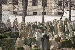 Old Jewish Cemetery, Prague. Prague, Czech Republic - March 17, 2017: Tombstones on the Old Jewish Cemetery in the Jewish quarter Royalty Free Stock Photo