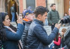 Prague, Czech Republic - March 15, 2017: Tourists taking pictures of the famous medieval astronomical clock in Prague stock photos