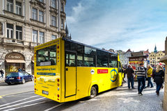 PRAGUE, CZECH REPUBLIC - MARCH 5, 2016: Yellow tourist bus stope Stock Images