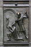 Bas-relief on St. Vitus Cathedral door in Prague. The murder of St. Wenceslas, a historic event stock photography