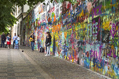 PRAGUE, CZECH REPUBLIC - May 21, 2015: John Lennon Wall with uni Stock Photo