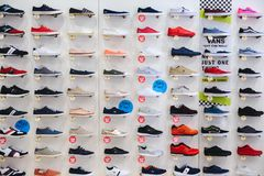 PRAGUE, CZECH REPUBLIC - MAY 2017: Lots of different sneakers on the showcase on market. Image of sport shoes on shop-window.  stock image