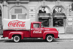 PRAGUE, CZECH REPUBLIC-MAY 15: a red retro car Ford F-100 with a. Dvertising inscription Coca Cola on board on the streets of Prague's Old Town May 15, 2015 Royalty Free Stock Image