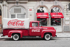 PRAGUE, CZECH REPUBLIC-MAY 15: a red retro car Ford F-100 with a. Dvertising inscription Coca Cola on board on the streets of Prague's Old Town May 15, 2015 Stock Images