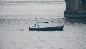 PRAGUE, CZECH REPUBLIC - MAY 3, 2018. Sailors in a motorboat. PRAGUE, CZECH REPUBLIC - MAY 3, 2018. Sailors in a motor boat royalty free stock photos