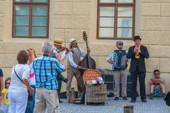 Prague, Czech Republic - 21.08.2018: musicians in the square of. Hradcany royalty free stock photos