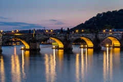 Prague, Czech Republic. Night photo of Charles Bridge, Castle and historical buildings Royalty Free Stock Photo