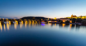 Prague, Czech Republic. Night photo of Charles Bridge, Castle and historical buildings Royalty Free Stock Photos