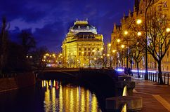 Prague Czech Republic nighttime view to national. Prague, Czech Republic. Nighttime view to National Theater Narodni Divadlo at promenade of river Vltava with stock photography