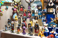 PRAGUE, CZECH REPUBLIC - Oct 24 2015: Showcase gift shop with Souvenirs and funny coloured figures of girls, cats, clay and wooden. Toys, at Old Town Square in Royalty Free Stock Photo