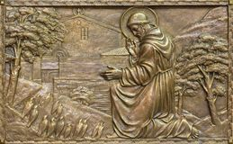PRAGUE, CZECH REPUBLIC - OCTOBER 13, 2018: The bronze relief of Preaching to the birdsof St. Francis of Assisi stock images