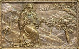 PRAGUE, CZECH REPUBLIC - OCTOBER 13, 2018: The bronze relief of the Stigmatization of St. Francis of Assisi stock photography