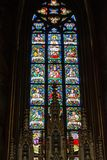 Colorful religious stained glass window in St. Vitus Cathedral i Royalty Free Stock Images