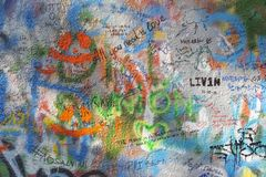PRAGUE, CZECH REPUBLIC - OCTOBER 12, 2018: Detail of John Lennon Peace Wall created in 1980 royalty free stock image