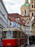 Prague, Czech Republic - October 31, 2018 Public transport Tram number 20 runs trhough Karmelitska street with the Saint Nicholas. Bell Tower in the background royalty free stock images