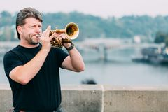 Street Busker performing jazz songs at the Charles Bridge in Prague. Royalty Free Stock Image