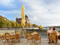 Prague, Czech Republic - October 30, 2018, A tourist couple contemplates Prague Lifestyle in a sunny afternoon fall. Prague, Czech Republic - October 30, 2018, A royalty free stock photography