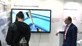 Prague, Czech Republic, October 1, 2017: Virtual robot control in the 3D space of chocolate factory, innovative stock video