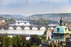 Prague, Czech Republic. Panorama of the old city from the embankment and bridges through the Vltava River Stock Images