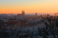 Prague. Czech Republic. Prague sunset in the fog Stock Photos