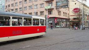 Prague, Czech Republic. Red and white trams in the streets of city center. Morning time stock video