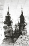 Prague, Czech Republic: a reflection in a puddle of the Cathedral. An artistic image. Black and white photo. Stock Photos