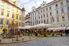 Prague, Czech Republic, 2017 10 26: restaurant and Hotel u Princ. E in the center of Prague`s old town - tables on the street Stock Image