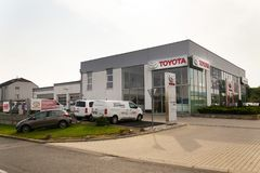 Cars in front of Toyota motor corporation dealership building Royalty Free Stock Images