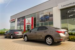 Cars in front of Toyota motor corporation dealership building Stock Photography