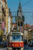 Prague, Czech Republic - September , 17, 2019: Driver of a Retro tram at old town of Prague, with henry`s tower on the stock photos