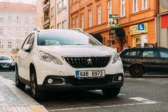 Front View Of White Peugeot 2008 Car Parked In Street. Mini Sport stock photo