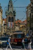 Prague, Czech Republic - September , 17, 2019: Pedestrians crossing the street at old town of Prague, with cars, tram royalty free stock photography