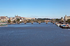 PRAGUE, CZECH REPUBLIC-SEPTEMBER 05, 2015: Photo of Palacky Bridge. Prague, Czech Republic - September 5, 2015: Image of the Vltava River with a stone bridge in Stock Photo
