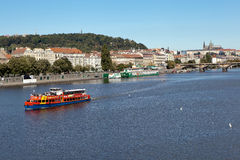 PRAGUE, CZECH REPUBLIC-SEPTEMBER 05, 2015: Photo of Red River sightseeing boat on the Vltava. Royalty Free Stock Photos