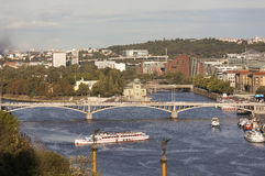PRAGUE, CZECH REPUBLIC -  SEPTEMBER 05, 2015: Photo of View of the Vltava River and bridges at sunset. Royalty Free Stock Photo