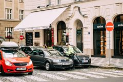 Prague, Czech Republic. Policeman Stop Skoda Taxi Car On Street. Prague, Czech Republic - September 22, 2017: Policeman Stop Skoda Taxi Car On Street Stock Photos