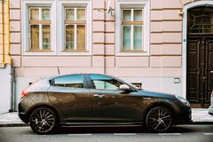 Side View Of Alfa Romeo Giulietta 940 Car Parked In Street. Prague, Czech Republic - September 23, 2017: Side View Of Alfa Romeo Giulietta 940 Car Of Black Royalty Free Stock Photos