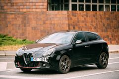 Side View Of Alfa Romeo Giulietta Veloce 940 Car Of Black Metallic. Prague, Czech Republic - September 23, 2017: Side View Of Alfa Romeo Giulietta Veloce 940 Car Stock Photos