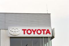 Toyota motor corporation logo on dealership building Royalty Free Stock Image