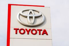 Cars in front of Toyota motor corporation dealership building Royalty Free Stock Photo