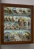PRAGUE, CZECH REPUBLIC. A show-window with souvenir models of the Prague astronomical clock (chiming clock). PRAGUE, CZECH REPUBLIC - MAY 28, 2014: A show-window Royalty Free Stock Image
