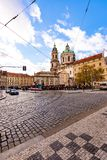 PRAGUE, CZECH REPUBLIC - 8.12.2018: St. Nicholas church on Prague city square. Peoples are waiting for tram near big city stock photography