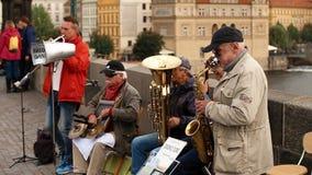 Prague, Czech Republic. Street Buskers Performing Jazz Songs At The Charles Bridge In Prague. Busking Is Legal Form Of. Prague, Czech Republic - September 23 stock footage