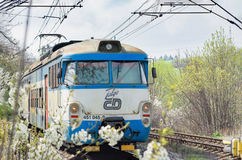 PRAGUE, CZECHIA - MAY 15, 2016: Train of Czech Railways company passing by during a spring sunny day royalty free stock photo